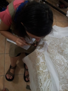 applying the wax with the canting